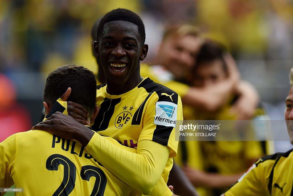 Dortmund's French midfielder Ousmane Dembele (C) celebrates during the German first division Bundesliga football match of Borussia Dortmund vs SV Darmstadt 98 in Dortmund, western Germany, on September 17, 2016. / AFP / PATRIK
