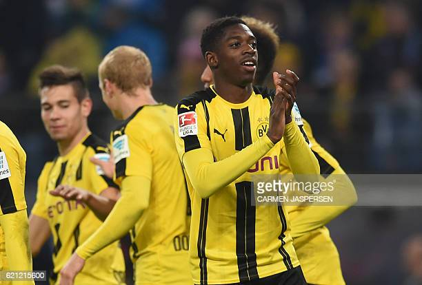 Dortmund's French midfielder Ousmane Dembele celebrates during the German first division Bundesliga football match between Hamburg SV and BVB...