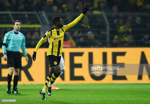 Dortmund's French midfielder Ousmane Dembele celebrates scoring during the German First division Bundesliga football match between Borussia Dortmund...