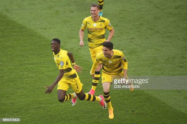 Dortmund's French midfielder Ousmane Dembele celebrates scoring the opening goal with his teammates during the German Cup final football match...