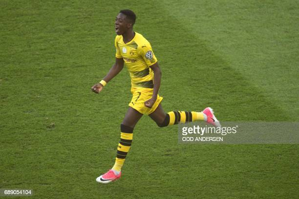 Dortmund's French midfielder Ousmane Dembele celebrates scoring the opening goal during the German Cup final football match Eintracht Frankfurt v BVB...