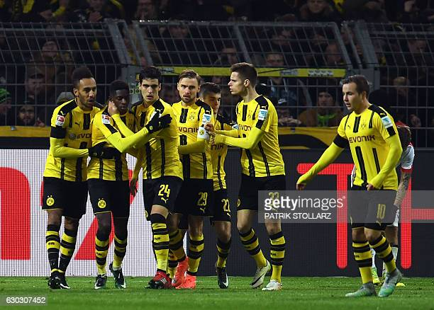 Dortmund's French midfielder Ousmane Dembele celebrates scoring with teammates during the German First division Bundesliga football match between...