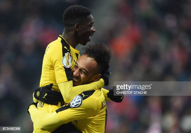 Dortmund's French midfielder Ousmane Dembele celebrates with Dortmund's Gabonese forward PierreEmerick Aubameyang after the second goal during the...