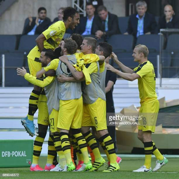 Dortmund's French midfielder Ousmane Dembele celebrates with teammates scoring the opening goal during the German Cup final football match Eintracht...