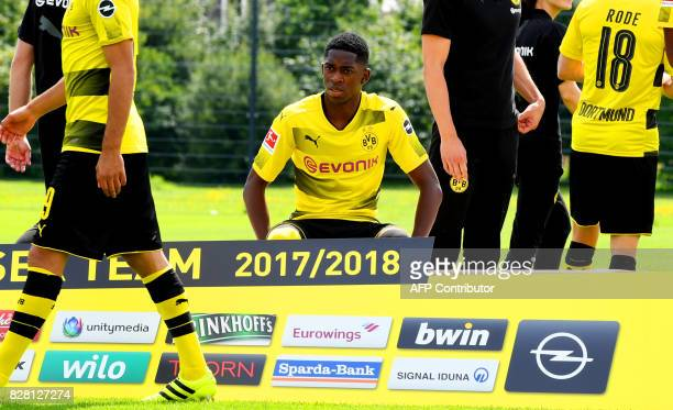 Dortmund's French midfielder Ousmane Dembele has taken seat for the team photo during a press event of German first division Bundesliga football club...