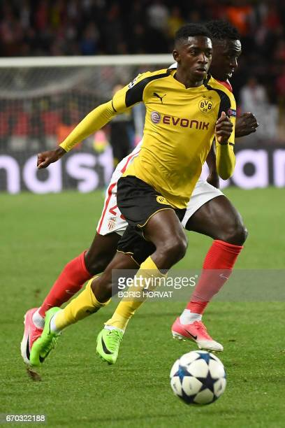Dortmund's French midfielder Ousmane Dembele outruns Monaco's French defender Benjamin Mendy during the UEFA Champions League 2nd leg quarterfinal...