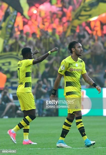 Dortmund's French midfielder Ousmane Dembele reacts after scoring next to Dortmund's Gabonese forward PierreEmerick Aubameyang vie for the ball...