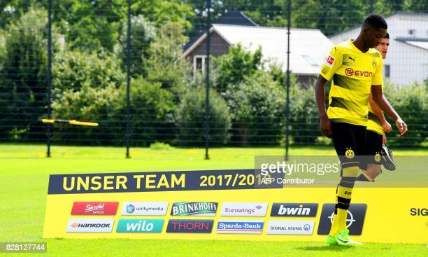 Dortmund's French midfielder Ousmane Dembele walks over the pitch during a press event of German first division Bundesliga football club Borussia...