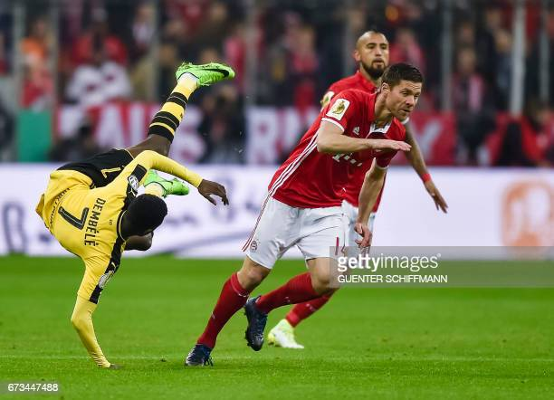Dortmund's French striker Ousmane Dembele and Bayern Munich's Spanish midfielder Xabi Alonso vie for the ball during the German Cup DFB Pokal...