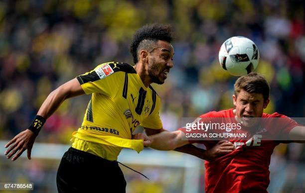 Dortmund's Gabonese forward PierreEmerick Aubameyang and Cologne's defender Dominique Heintz vie for the ball during the German first division...