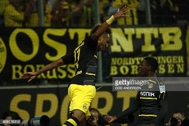 Dortmund's Gabonese forward PierreEmerick Aubameyang and Dortmund's French midfielder Ousmane Dembele celebrate during the German first division...