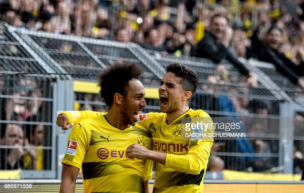 TOPSHOT Dortmund's Gabonese forward PierreEmerick Aubameyang and Dortmund's Spanish defender Marc Bartra celebrate the 43 during the German first...