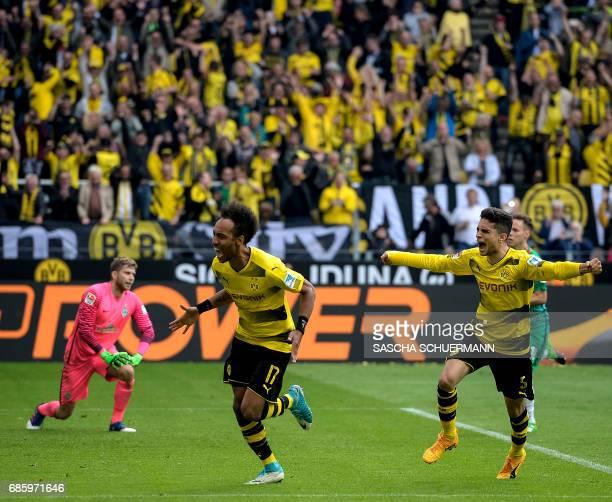 Dortmund's Gabonese forward PierreEmerick Aubameyang and Dortmund's Spanish defender Marc Bartra celebrate the 43 during the German first division...