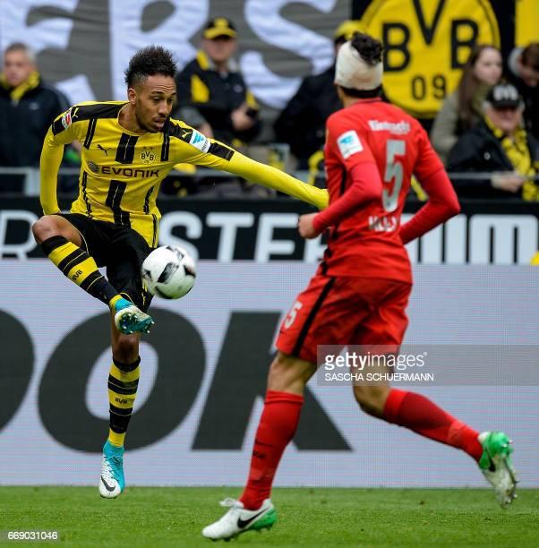Dortmund's Gabonese forward PierreEmerick Aubameyang and Frankfurt's Spanish defender Jesus Vallejo vie for the ball during the German First division...