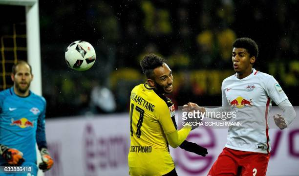 Dortmund's Gabonese forward PierreEmerick Aubameyang and Leipzig's Brazilian defender Bernardo vie for the ball during the German First division...