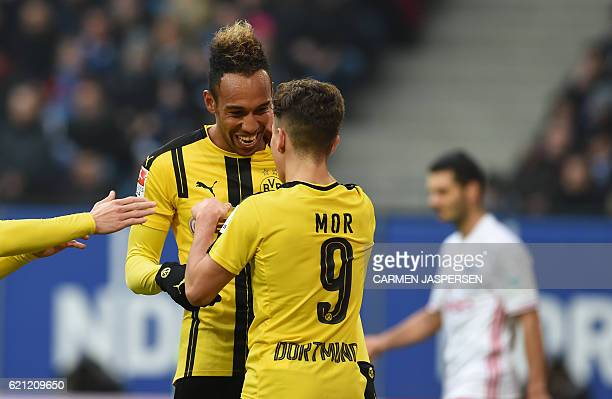 Dortmund's Gabonese forward PierreEmerick Aubameyang celebrate scoring with Dortmund's Turkish midfielder Emre Mor during the German first division...