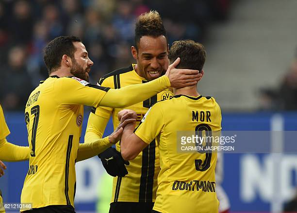 Dortmund's Gabonese forward PierreEmerick Aubameyang celebrate scoring with Dortmund's Turkish midfielder Emre Mor and Dortmund's midfielder Gonzalo...