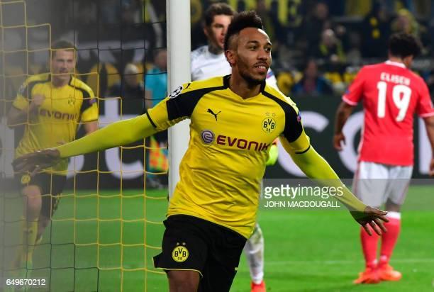 Dortmund's Gabonese forward PierreEmerick Aubameyang celebrate scoring the 30 goal during the UEFA Champions League Round of 16 2ndleg football match...