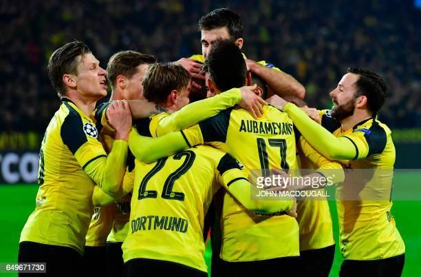 TOPSHOT Dortmund's Gabonese forward PierreEmerick Aubameyang celebrate scoring the 30 goal with his teammates during the UEFA Champions League Round...