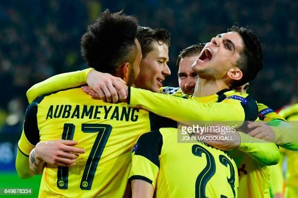 Dortmund's Gabonese forward PierreEmerick Aubameyang celebrate scoring a hattrick the 40 goal with his teammates during the UEFA Champions League...