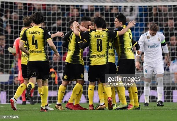 Dortmund's Gabonese forward PierreEmerick Aubameyang celebrates a goal with teammates during the UEFA Champions League group H football match Real...
