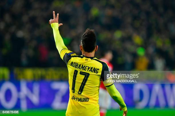 Dortmund's Gabonese forward PierreEmerick Aubameyang celebrates scoring a hattrick the 40 goal during the UEFA Champions League Round of 16 2ndleg...
