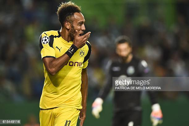 Dortmund's Gabonese forward PierreEmerick Aubameyang celebrates after scoring during the UEFA Champions League football match Sporting CP vs BVB...