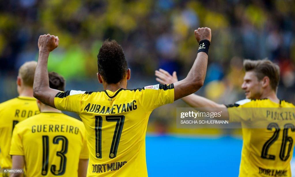 Dortmund's Gabonese forward Pierre-Emerick Aubameyang celebrates after the German first division Bundesliga football match between Borussia Dortmund and TSG 1899 Hoffenheim on May 6, 2017 in Dortmund, western Germany. /