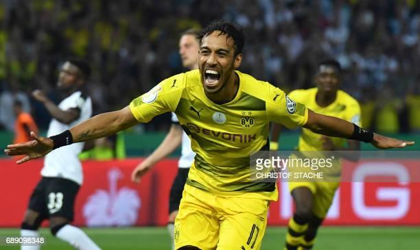 Dortmund's Gabonese forward PierreEmerick Aubameyang celebrates after scoring a penalty goal during the German Cup final football match Eintracht...