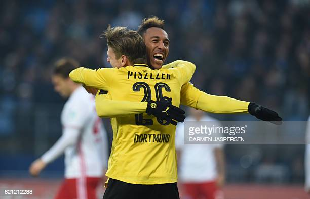 Dortmund's Gabonese forward PierreEmerick Aubameyang celebrates scoring his 4th goal with Dortmund's Polish defender Lukasz Piszczek during the...