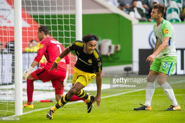 Dortmund's Gabonese forward PierreEmerick Aubameyang celebrates scoring his side's third goal past Wolfsburg's Belgian goalkeeper Koen Casteels...