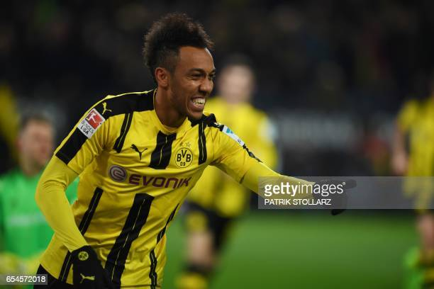 Dortmund's Gabonese forward PierreEmerick Aubameyang celebrates scoring the opening goal with his teammates during the German First division...