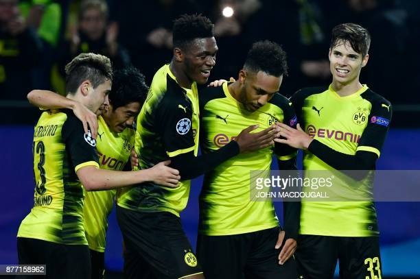 Dortmund's Gabonese forward PierreEmerick Aubameyang celebrates scoring the opening goal with his teammates during the UEFA Champions League Group H...