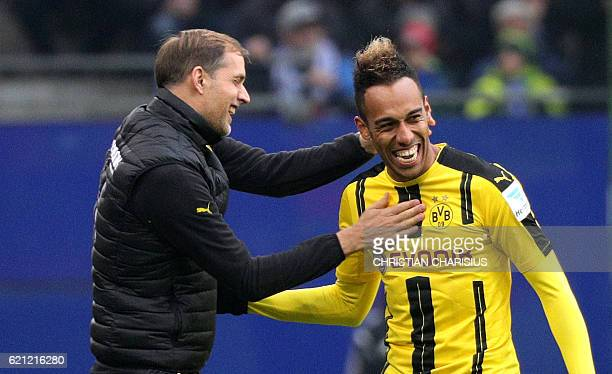 Dortmund's Gabonese forward PierreEmerick Aubameyang celebrates scoreing with Dortmund's head coach Thomas Tuchel during the German first division...