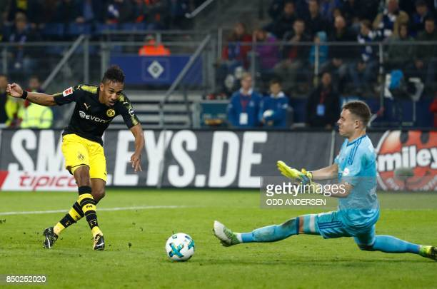 Dortmund's Gabonese forward PierreEmerick Aubameyang fails to score past Hamburg's German goalkeeper Christian Mathenia during the German first...