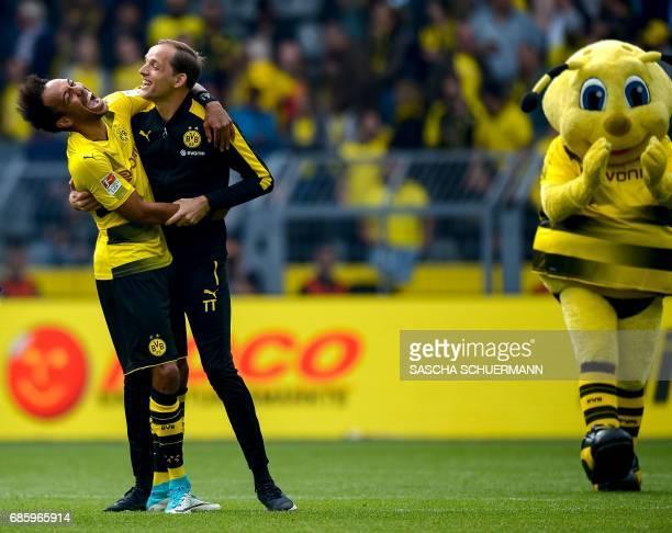 Dortmund's Gabonese forward PierreEmerick Aubameyang hugs Dortmund's head coach Thomas Tuchel after the German first division football match between...