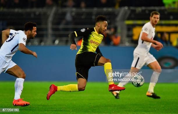 TOPSHOT Dortmund's Gabonese forward PierreEmerick Aubameyang runs with the ball during the UEFA Champions League Group H football match BVB Borussia...