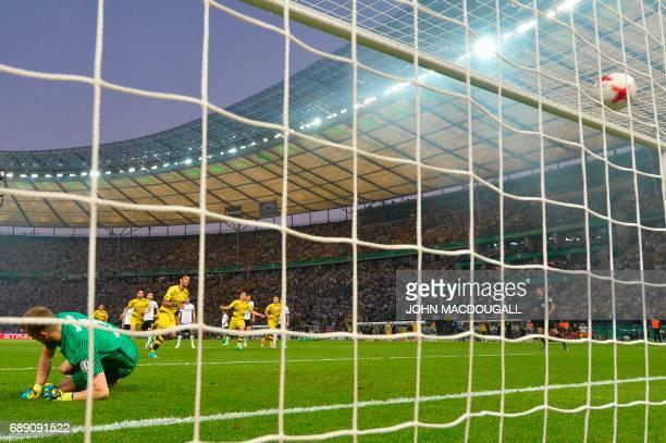 Dortmund's Gabonese forward PierreEmerick Aubameyang scores a penalty as Frankfurt's Finnish goalkeeper Lukas Hradecky fails to save during the...