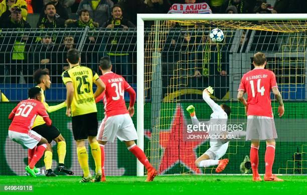 Dortmund's Gabonese forward PierreEmerick Aubameyang scores the opening goal past Benfica's Brazilian goalkeeper Ederson Moraes during the UEFA...