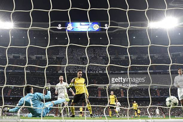 Dortmund's Gabonese forward PierreEmerick Aubameyang shoots to score a goal in front of Real Madrid's Costa Rican goalkeeper Keylor Navas during the...