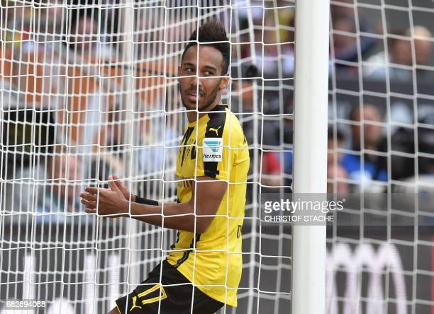 Dortmund's Gabonese forward PierreEmerick Aubameyang stands in the goal during the German first division Bundesliga football match between FC...