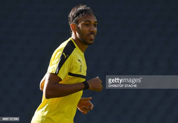 Dortmund's Gabonese forward PierreEmerick Aubameyang takes part in a training session on the eve of the German Cup football final match between...