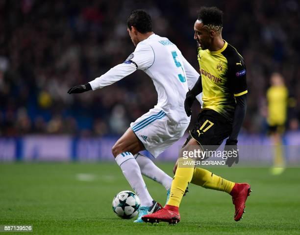 Dortmund's Gabonese forward PierreEmerick Aubameyang vies with Real Madrid's French defender Raphael Varane during the UEFA Champions League group H...