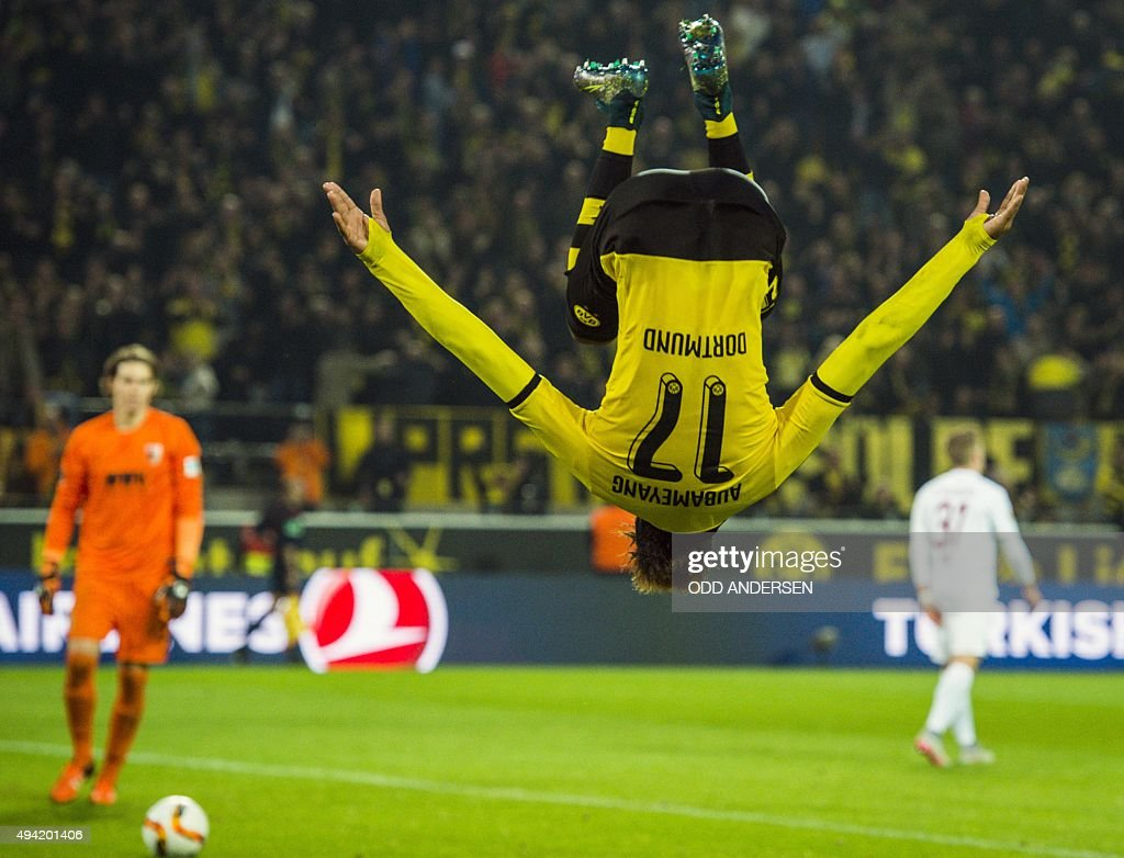 Dortmund's Gabonese midfielder PierreEmerick Aubameyang somersaults as he celebrates scoring his side's 5th goal to complete his hattrick during the...