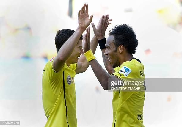 Dortmund's Gabonese PierreEmerick Aubameyang and his teammate Dortmund's Polish striker Robert Lewandowski celebrate after the third goal for...