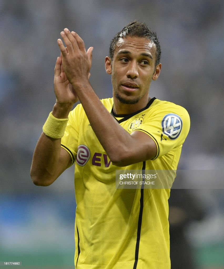 Dortmund's Gabonese Pierre-Emerick Aubameyang celebrates after the second round football match of the German Cup (DFB - Pokal) TSV 1860 Munich vs Borussia Dortmund on September 24, 2013 in Munich, southern Germany. STACHE