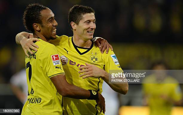 Dortmund's Gabonese striker PierreEmerick Aubameyang and Dortmund's Polish striker Robert Lewandowski celebrate after winning the German first...