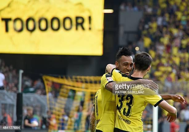 Dortmund's Gabonese striker PierreEmerick Aubameyang and Dortmund's midfielder Julian Weigl celebrate during the German first division Bundesliga...