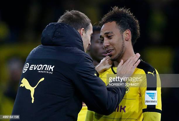 Dortmund's Gabonese striker PierreEmerick Aubameyang and Dortmund's head coach Thomas Tuchel celebrate after the German first division Bundesliga...