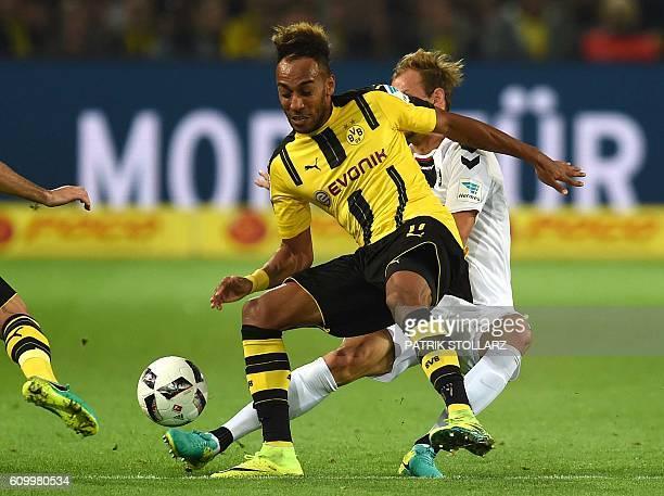 Dortmund's Gabonese striker PierreEmerick Aubameyang and Freiburg´s striker Maximilian Philipp vie for the ball during the German first division...